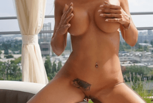 hot escort playing with perfect tits
